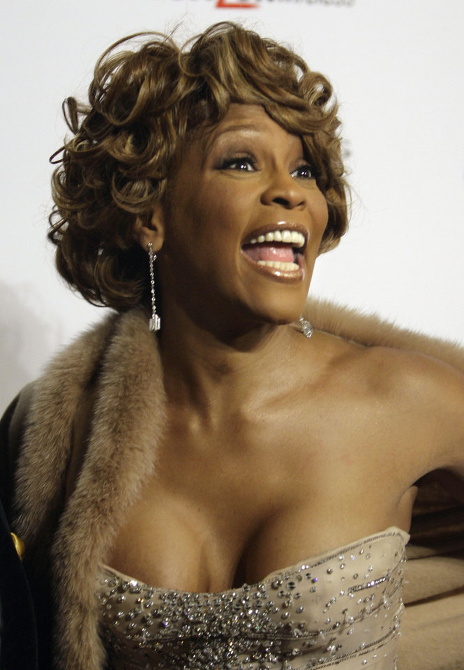 Whitney Houston arrives for the Clive Davis Pre-Grammy Party in Beverly Hills, Calif., Saturday, Feb. 10, 2007.  The 49th Annual Grammy Awards will air live on Sunday, Feb. 11 at the Staples Center in Los Angeles.  (AP Photo/Danny Moloshok)  ORG XMIT: CADB150