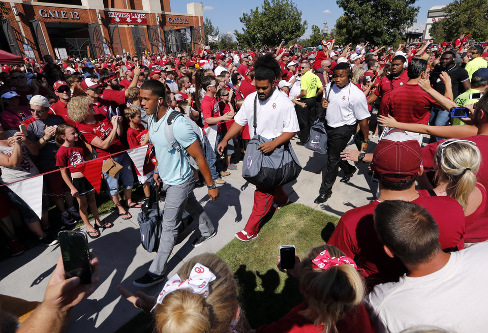 Photo - Sooner players participate in the new Walk of Champions before a college football game between the University of Oklahoma Sooners (OU) and the Louisiana Tech Bulldogs at Gaylord Family-Oklahoma Memorial Stadium in Norman, Okla., on Saturday, Aug. 30, 2014. Photo by Steve Sisney, The Oklahoman