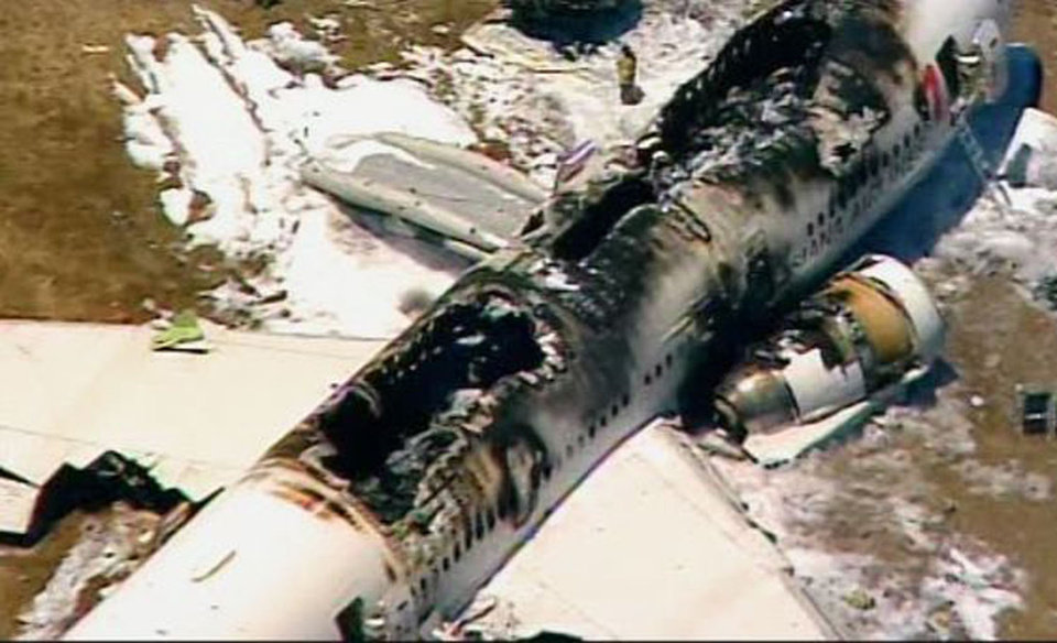 Photo - This frame grab from video provided by KTVU shows the scene after an Asiana Airlines flight crashed while landing at San Francisco Airport on Saturday, July 6, 2013, in San Francisco. (AP Photo/KTVU) MANDATORY CREDIT