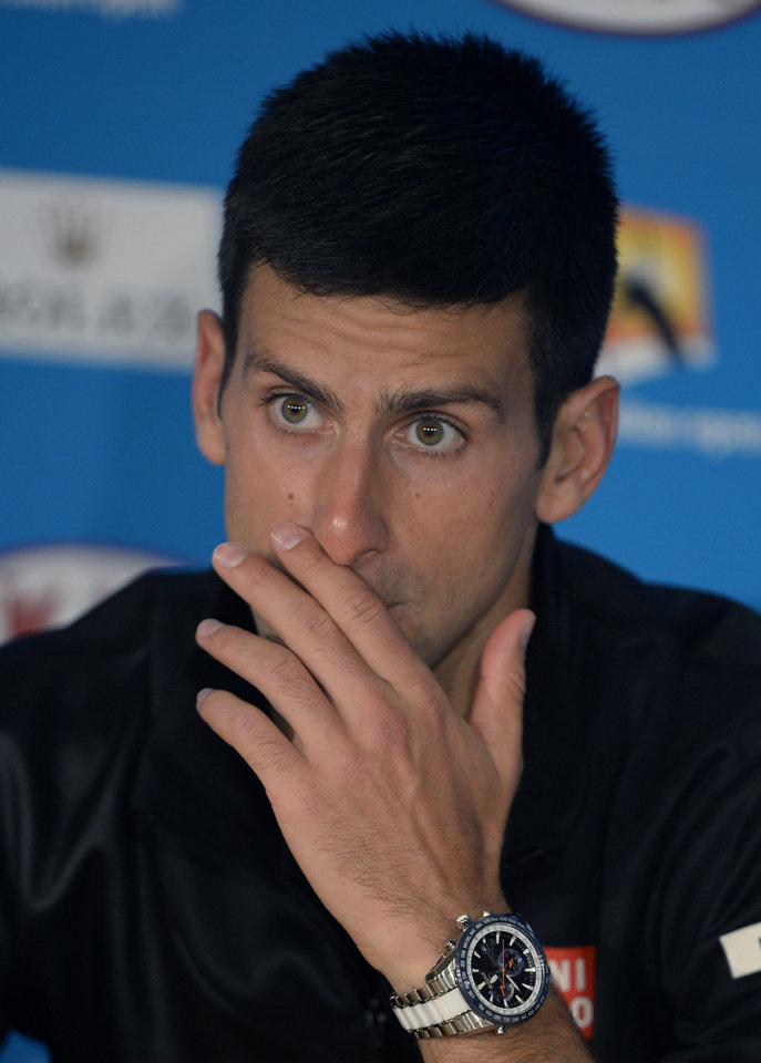 Photo - Novak Djokovic of Serbia gestures at a press conference following his quarterfinal loss to Stanislas Wawrinka of Switzerland at the Australian Open tennis championship in Melbourne, Australia, Tuesday, Jan. 21, 2014. (AP Photo/Andrew Brownbill)