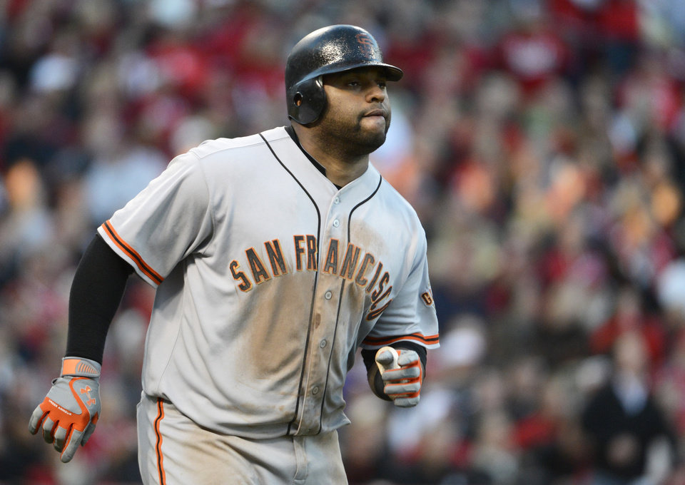 Photo -   San Francisco Giants' Pablo Sandoval watches his two-run home run in the seventh inning of Game 4 of the National League division baseball series against the Cincinnati Reds, Wednesday, Oct. 10, 2012, in Cincinnati. (AP Photo/Michael Keating)