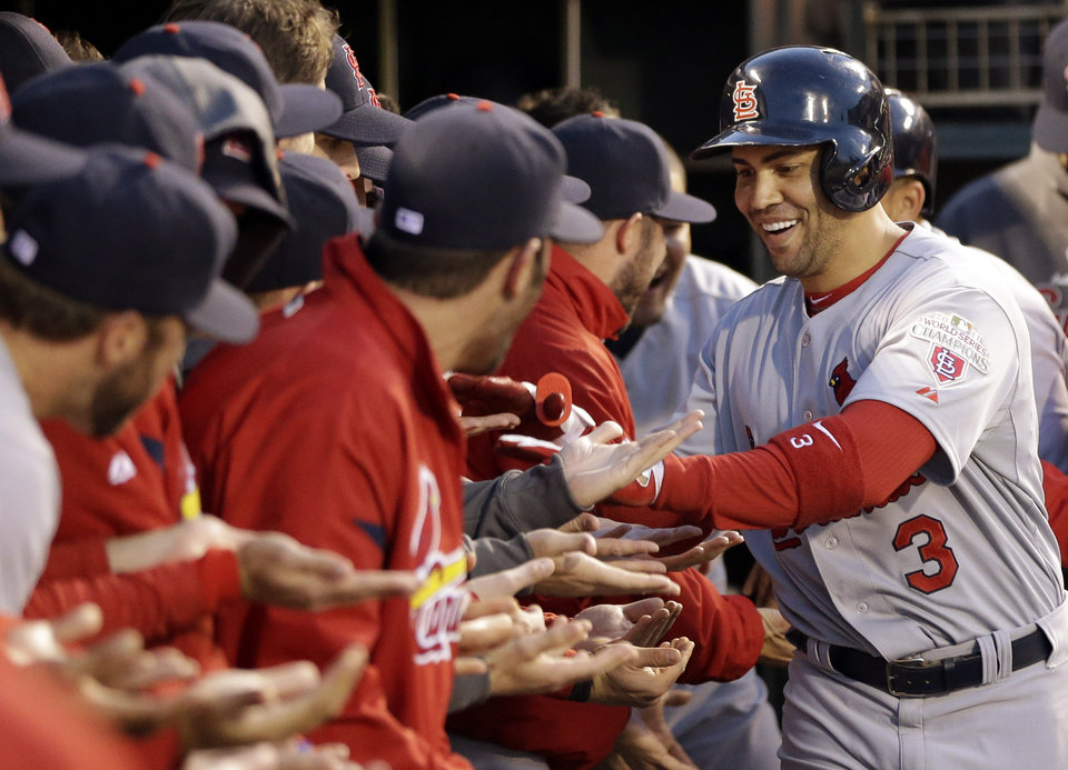 St. Louis Cardinals\' Carlos Beltran (3) is congratulated in the dugout after hitting a two-run home run during the fourth inning in Game 1 of baseball\'s National League championship series against the San Francisco Giants Sunday, Oct. 14, 2012, in San Francisco. (AP Photo/David J. Phillip)