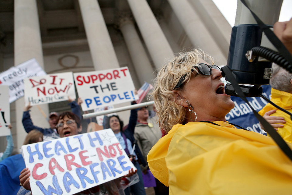 Susan McCann uses a megaphone as she helps lead a Health Care Reform march and rally on the south side of the State Capitol in Oklahoma City on Sunday, Sept. 13, 2009.  By John Clanton, The Oklahoman