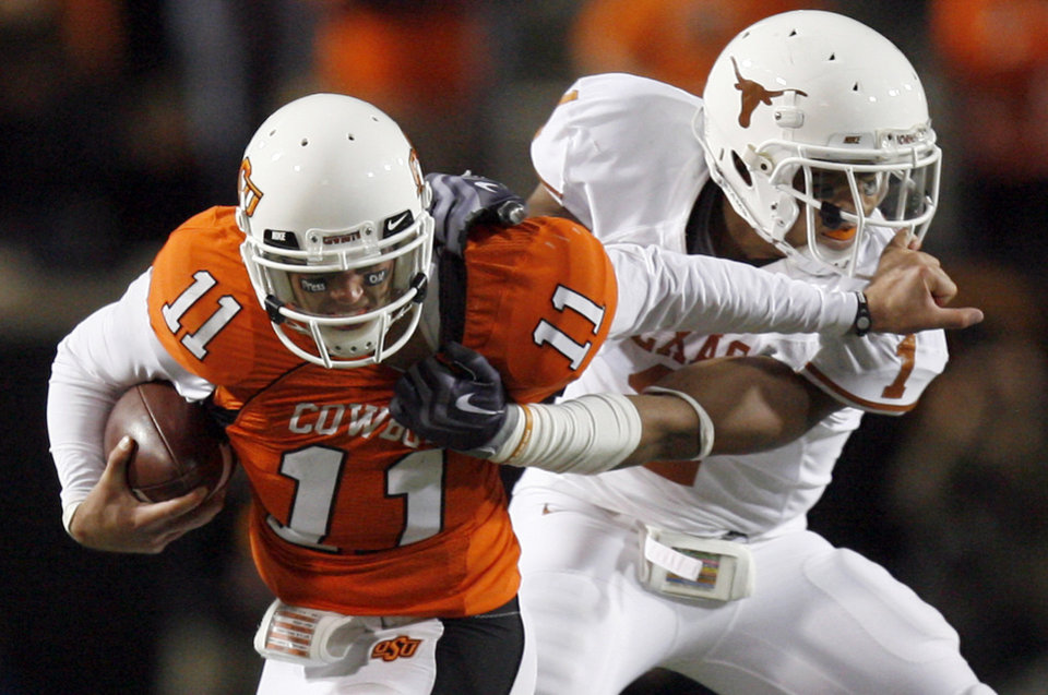 Zac Robinson stiff arms a defender in OSU's 41-14 loss to Texas. Photo by Sarah Phipps, The Oklahoman
