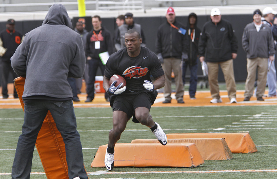 Photo - Kendall Hunter runs through drills for NFL scouts during the NFL pro day at Oklahoma State University on Wednesday, March 9, 2011, in Stillwater, Okla.  Photo by Chris Landsberger, The Oklahoman