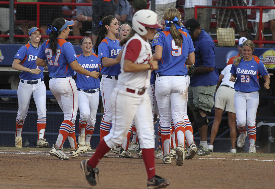 Photo - Florida teammates celebrate during the Women's College World Series game between Alabama and Florida at the ASA Hall of Fame Stadium in Oklahoma City, Sunday, June 5, 2011. Photo by Garett Fisbeck, The Oklahoman