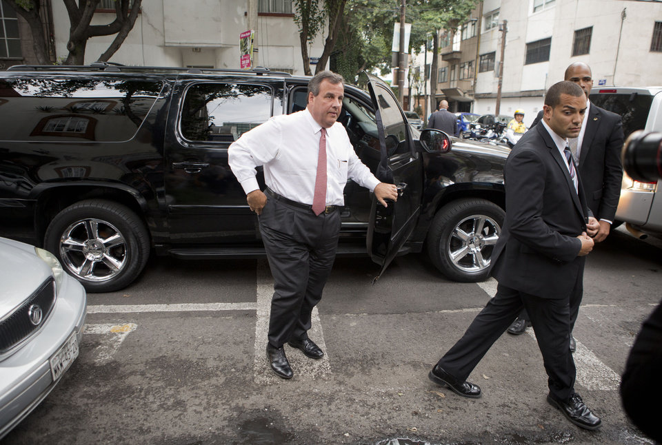 Photo - New Jersey Gov. Chris Christie is accompanied by a security detail as he arrives to have lunch at Tacos El Caminero in Mexico City, Thursday, Sept. 4, 2014. The potential 2016 U.S. presidential contender has called his three-day trade mission to Mexico a learning opportunity. (AP Photo/Rebecca Blackwell)