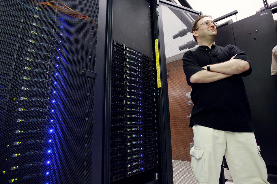 Photo - Henry Neeman, director of the University of Oklahoma Supercomputing Center for Education and Research shows OU's