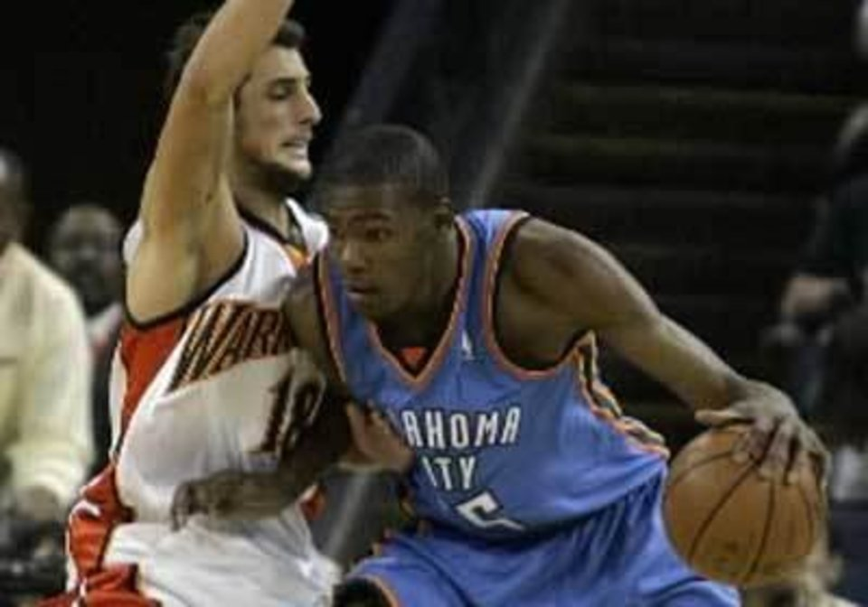 Oklahoma City Thunder  Kevin  Durant, right, drives against Golden State Warriors' Marco Belinelli, of Italy, during the first half of a preseason NBA basketball game Saturday, Oct. 11, 2008, in Oakland, Calif. AP Photo/Ben Margot