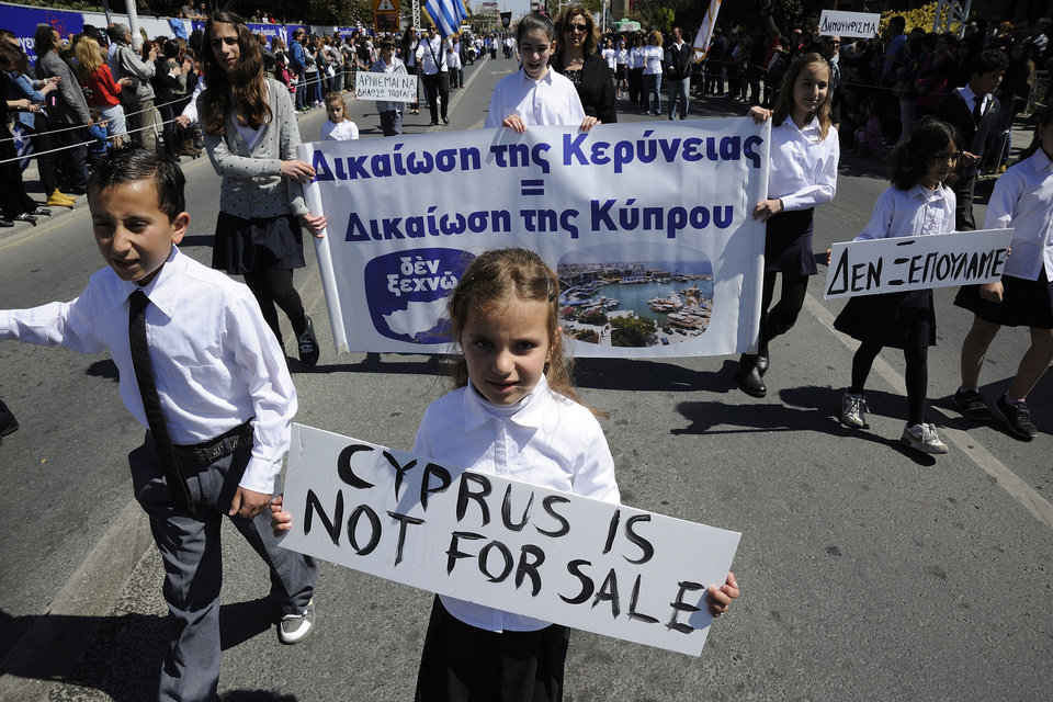 Photo - Students hold placards the ones on the right reads in Greek