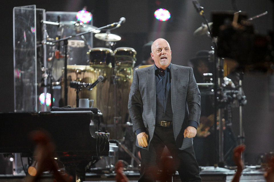 This image released by Starpix shows Billy Joel at the 12-12-12 The Concert for Sandy Relief at Madison Square Garden in New York on Wednesday, Dec. 12, 2012. Proceeds from the show will be distributed through the Robin Hood Foundation. (AP Photo/Starpix, Dave Allocca)