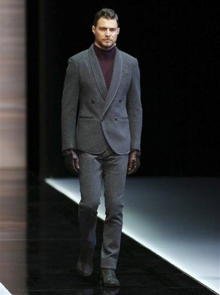 A model wears a creation for Giorgio Armani men\'s Fall-Winter 2013-14 collection, part of the Milan Fashion Week, unveiled in Milan, Italy, Tuesday, Jan. 15, 2013. (AP Photo/Antonio Calanni)