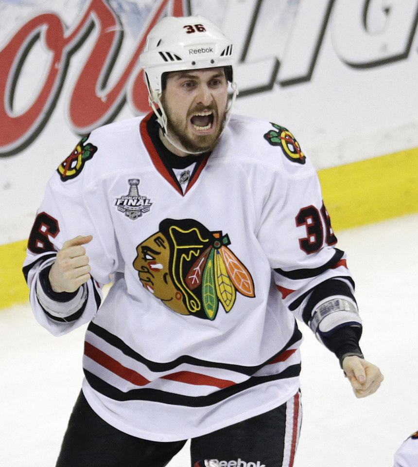 Photo - Chicago Blackhawks center Dave Bolland (36) celebrates his game winning goal against the Boston Bruins during the third period in Game 6 of the NHL hockey Stanley Cup Finals, Monday, June 24, 2013, in Boston. The Blackhawks won 3-2. (AP Photo/Charles Krupa)