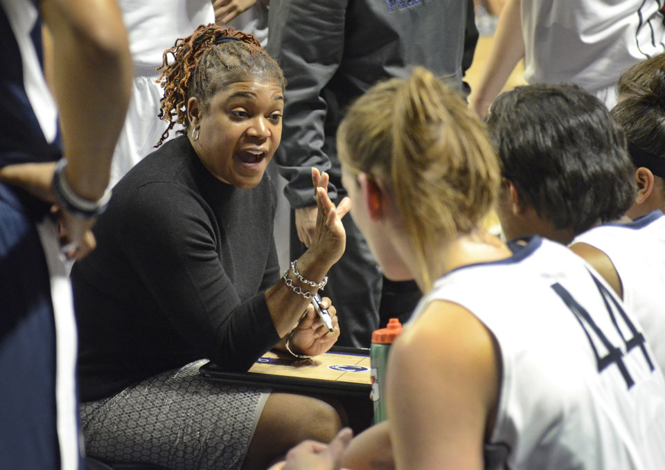 Photo - Penn State head coach Coquese Washington leads her team during the first half of an NCAA college basketball game against Connecticut, Sunday, Nov. 17, 2013, in State College, Pa. Connecticut defeated Penn State 71-52. (AP Photo/John Beale)
