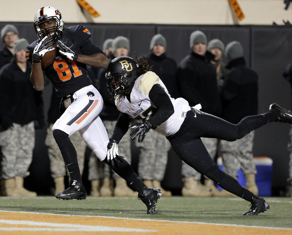Oklahoma State's Jhajuan Seales (81) catches a touchdown pass as Baylor's Joe Williams (22) defends in the fourth quarter during a college football game between the Oklahoma State University Cowboys (OSU) and the Baylor University Bears (BU) at Boone Pickens Stadium in Stillwater, Okla., Saturday, Nov. 23, 2013. Photo by Sarah Phipps, The Oklahoman