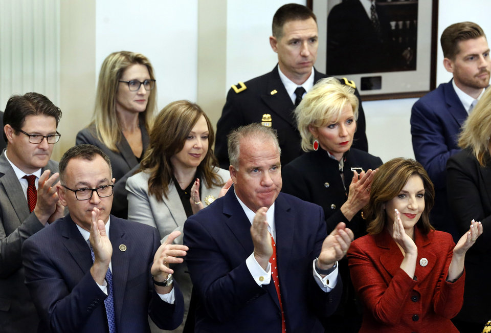 Photo - Members of Gov. Stitt's administration stand to applaud during his speech. Gov. Stitt said teachers deserve another pay raise and asked state lawmaker for the money to fund it in his first State-of-the-State address, which he also used to outline his vision for an economy-focused administration that will produce an efficient and adaptive state government. He outlined his plans moving forward in his first term as governor while speaking to lawmakers on Monday, Feb. 4, 2019, as the 57th Legislature officially began.  Photo by Jim Beckel, The Oklahoman.