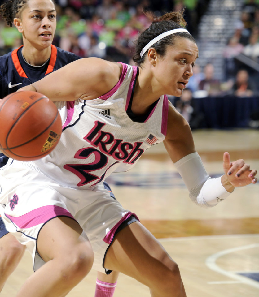 Photo - Notre Dame guard Kayla McBride drives the lane during second half action in an NCAA college basketball game against Syracuse, Sunday, Feb. 9, 2014 in South Bend, Ind. Notre Dame won 101-64 with McBride scoring 18 points. (AP Photo/Joe Raymond)