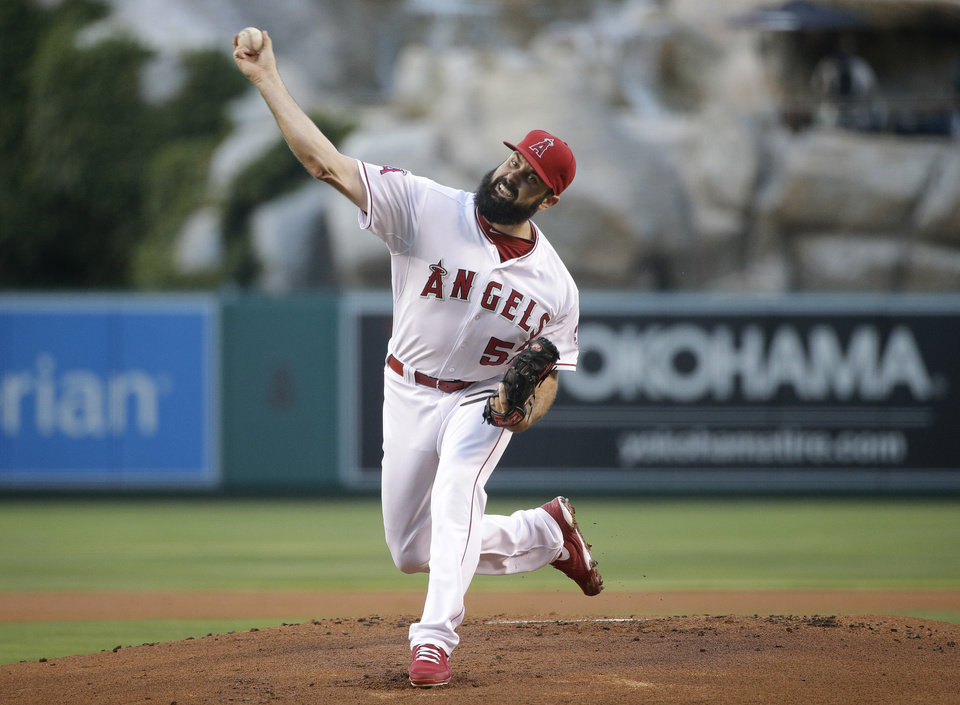 Photo - Los Angeles Angels starting pitcher Matt Shoemaker throws against the Los Angeles Dodgers during the first inning of a baseball game Wednesday, Aug. 6, 2014, in Anaheim, Calif. (AP Photo/Jae C. Hong)