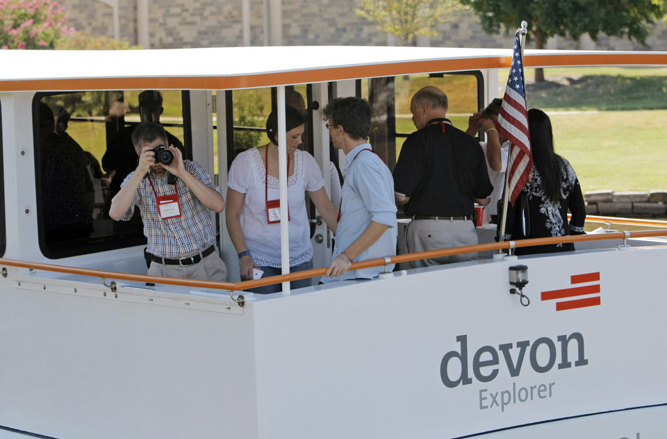 People stand in the stern of the Devon Explorer river cruiser at the start of a tour of the Oklahoma River for a group with the Topeka Chamber of Commerce, in Oklahoma City, Thursday, Sept. 2, 2010. Photo by Nate Billings, The Oklahoman