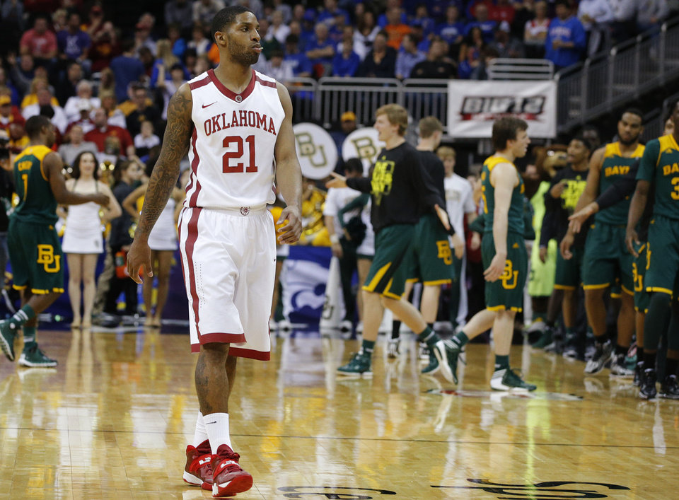 Photo - Oklahoma's Cameron Clark (21) walks off the court after Oklahoma's loss in the Big 12 Tournament college basketball game between the University of Oklahoma and Baylor at the Sprint Center in Kansas City, Mo., Thursday, March 13, 2014. Baylor won 78-73.  Photo by Bryan Terry, The Oklahoman