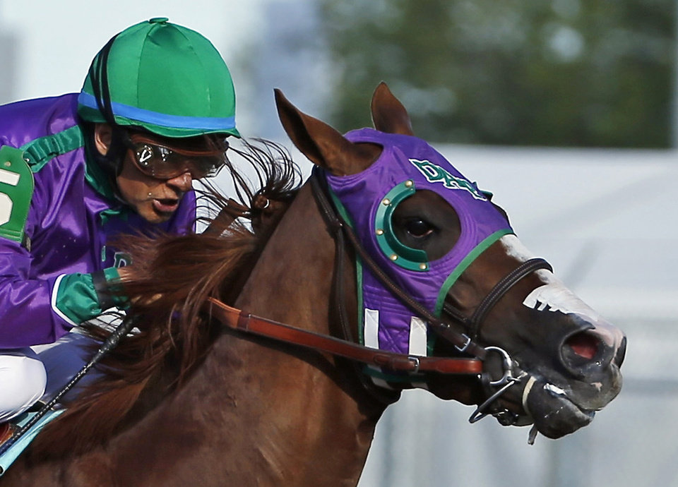 Photo - FILE - In this May 3, 2014, file photo, jockey Victor Espinoza rides California Chrome to win the 140th running of the Kentucky Derby horse race at Churchill Downs in Louisville, Ky.Chrome might abandon his Triple Crown bid if New York officials do not allow the colt to wear a nasal strip in the Belmont Stakes. Trainer Art Sherman made no threats about the Kentucky Derby and Preakness winner passing on a chance to become horse racing's 12th Triple Crown winner, but he suggested it was a possibility. (AP Photo/Matt Slocum, File)