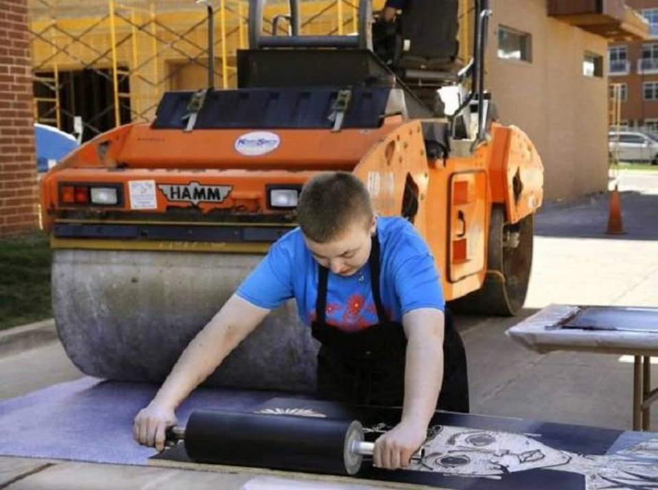 Photo - Artspace at Untitled's 2017 Steamroller Print Festival featured the inking printing of large-scale carved wooden blocks with a 5-ton steamroller. [The Oklahoman]