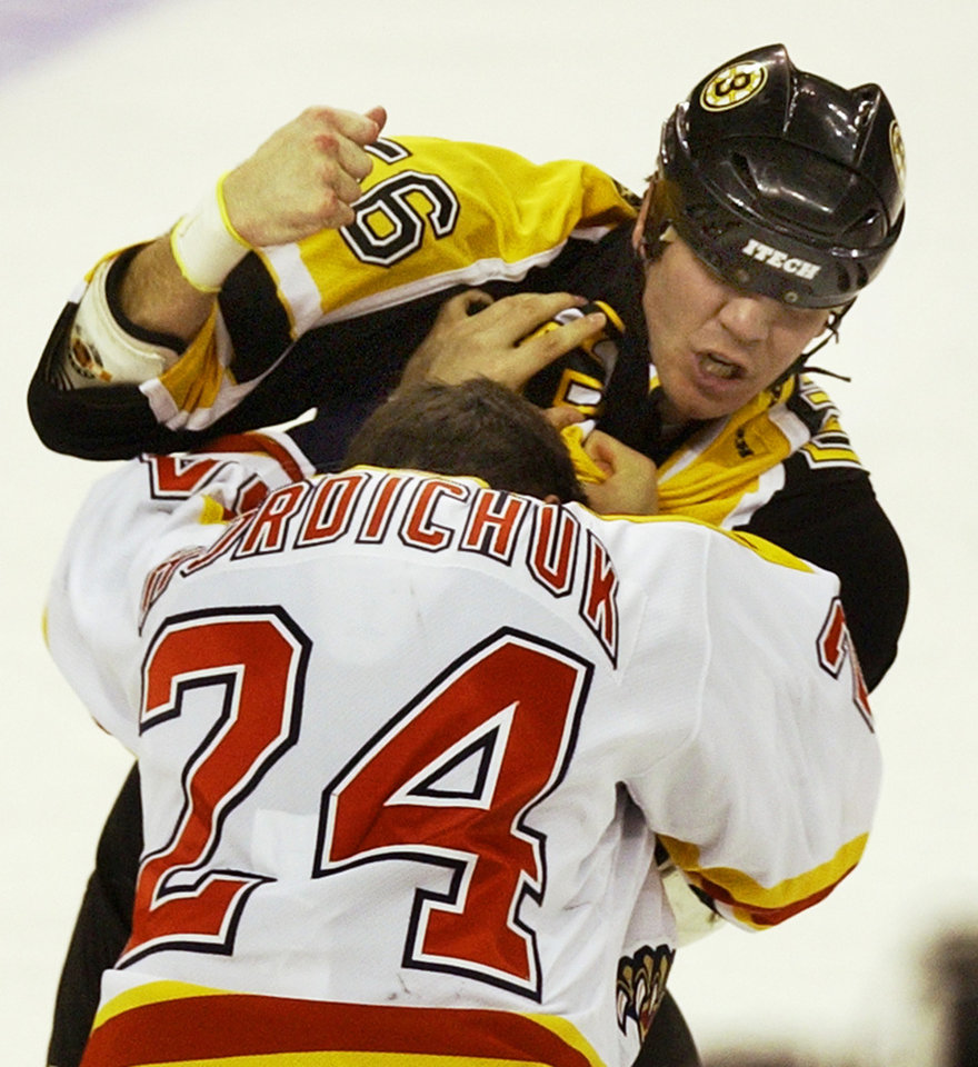 NHL HOCKEY, FIGHT: Boston Bruins' Doug Doull (56) fights with Florida Panthers' Darcy Hordichuk (24) during the second period in Boston Monday, Feb. 23, 2004. (AP Photo/Elise Amendola)