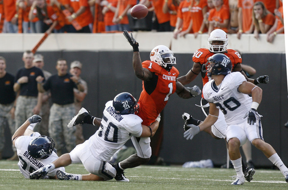 Photo - OSU's Dez Bryant (1) fumbles at the college football game between Oklahoma State University (OSU) and Rice University at Boone Pickens Stadium in Stillwater, Okla., Saturday, Sept. 19, 2009. Photo by Sarah Phipps, The Oklahoman ORG XMIT: KOD