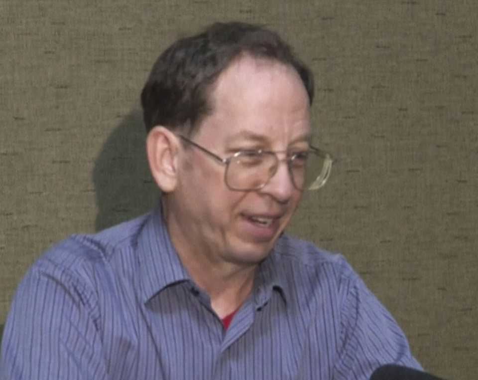 "Photo - In this image taken from video, U.S. citizen Jeffrey Edward Fowle speaks at an undisclosed location in North Korea Friday, Aug. 1, 2014. Two Americans, Fowle and Matthew Todd Miller, charged with ""anti-state"" crimes in North Korea say in a video that they expect to be tried soon and possibly receive long prison terms, and appeal for help from the U.S. government. They made the comments in the video shot by a local AP Television News crew. The crew was taken to a location to meet the detained Americans after repeated requests to North Korean authorities to see them. (AP Photo/APTN)"