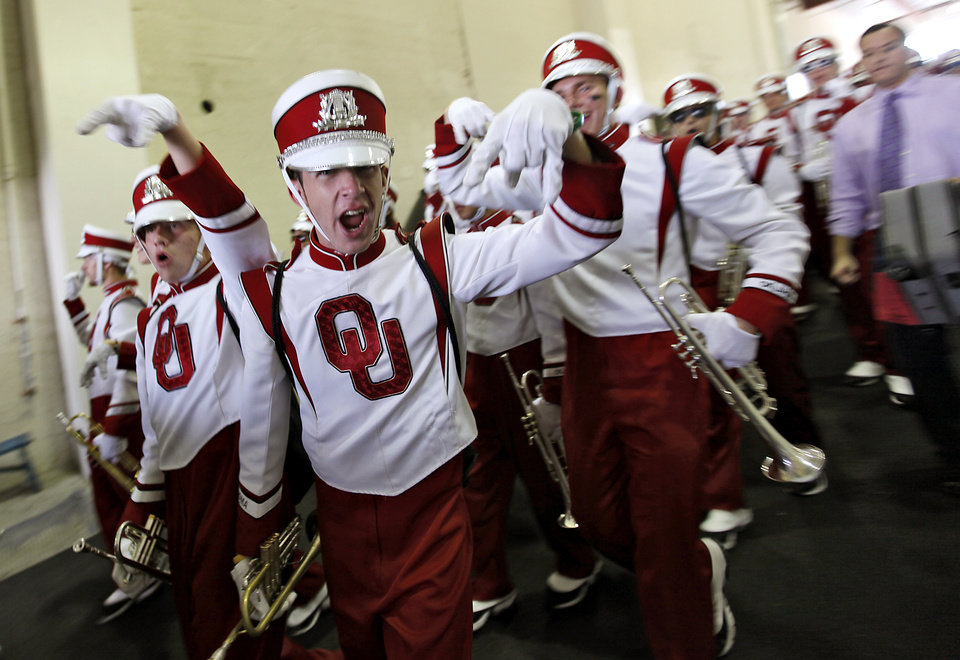 Photo - The Pride of Oklahoma marching band makes their way to the field before the start of the Red River Rivalry college football game between the University of Oklahoma Sooners (OU) and the University of Texas Longhorns (UT) at the Cotton Bowl in Dallas, Saturday, Oct. 8, 2011. Photo by Chris Landsberger, The Oklahoman