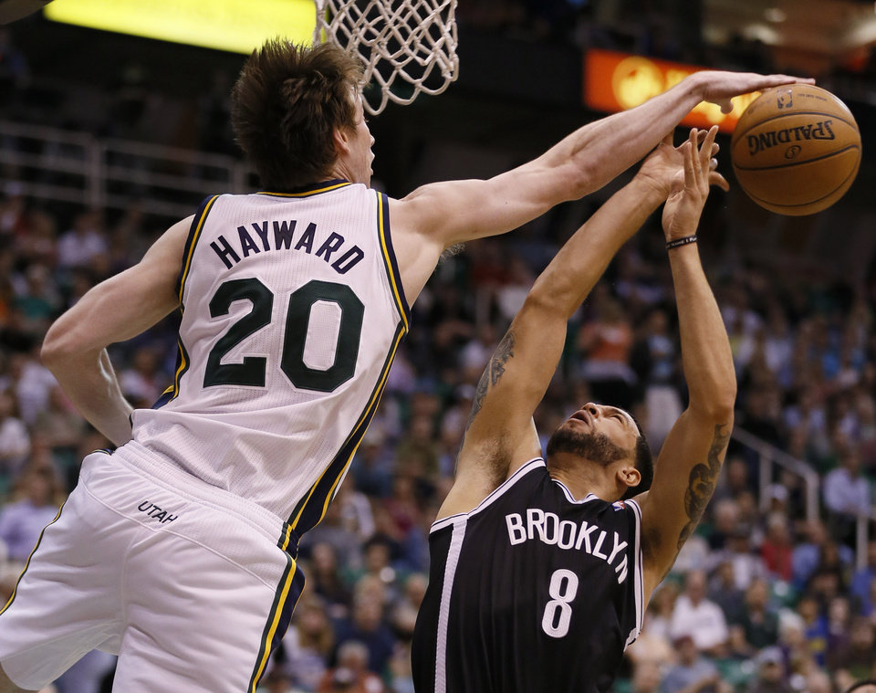 Brooklyn Nets' Deron Williams, right, has his shot blocked by the Utah Jazz's Gordon Hayward during the first half of an NBA basketball game, Saturday, March 30, 2013, in Salt Lake City. (AP Photo/George Frey)