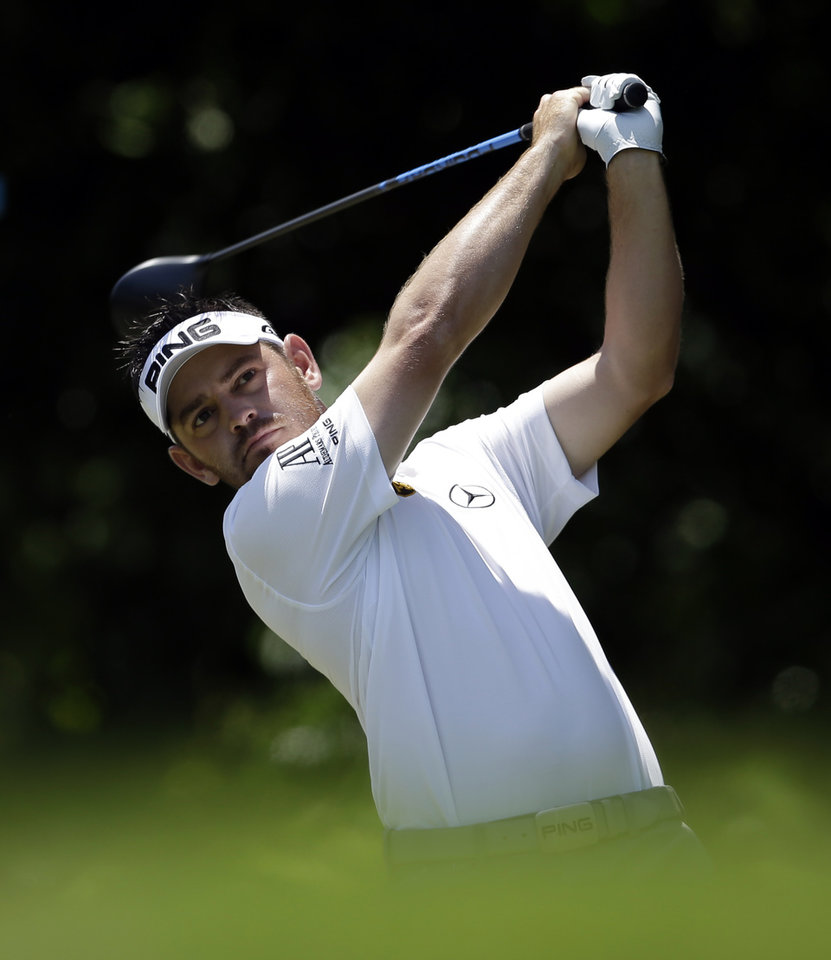 Photo - Louis Oosthuizen of South Africa hits off the first tee during the final round of the Byron Nelson Championship golf tournament, Sunday, May 18, 2014, in Irving, Texas. (AP Photo/Tony Gutierrez)