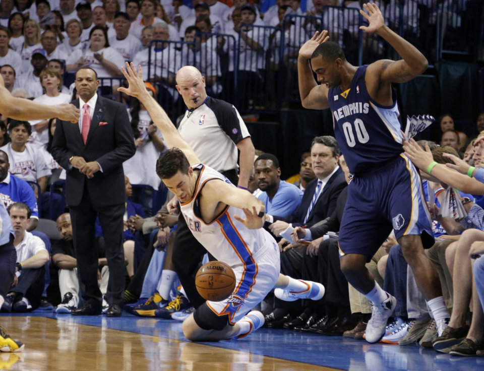 Oklahoma City\'s Nick Collison goes for the ball beside Memphis\' Tony Allen during Game 2 in the second round of the NBA playoffs between the Oklahoma City Thunder and the Memphis Grizzlies at Chesapeake Energy Arena In Oklahoma City, Tuesday, May 7, 2013. Photo by Bryan Terry, The Oklahoman