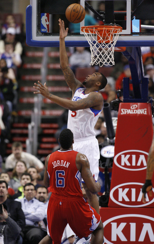 Philadelphia 76ers' Arnett Moultrie (5) scores against Los Angeles Clippers' DeAndre Jordan in the first half of an NBA basketball game, Monday, Feb. 11, 2013, in Philadelphia. (AP Photo/H. Rumph Jr)