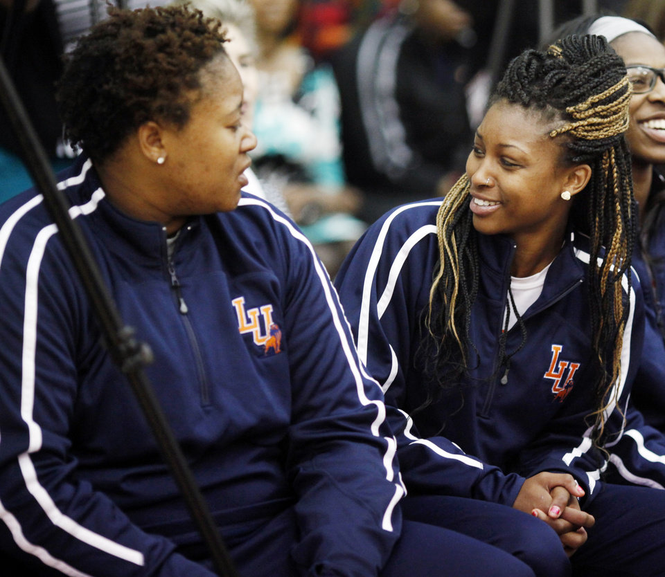 Photo - Langston women's basketball players Alex Adekunle (left) and Kashyla Fields (right) look at each other in surprise after new head coach Cheryl Miller describes their summer training program at a press conference in Langston on Tuesday, April 29, 2014 Photo by KT King, The Oklahoman