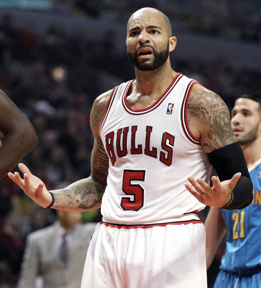 Chicago Bulls forward Carlos Boozer (5) reacts to a call during the first half of an NBA basketball game against the New Orleans Hornets in Chicago, Saturday, Nov. 3, 2012. (AP Photo/Nam Y. Huh)