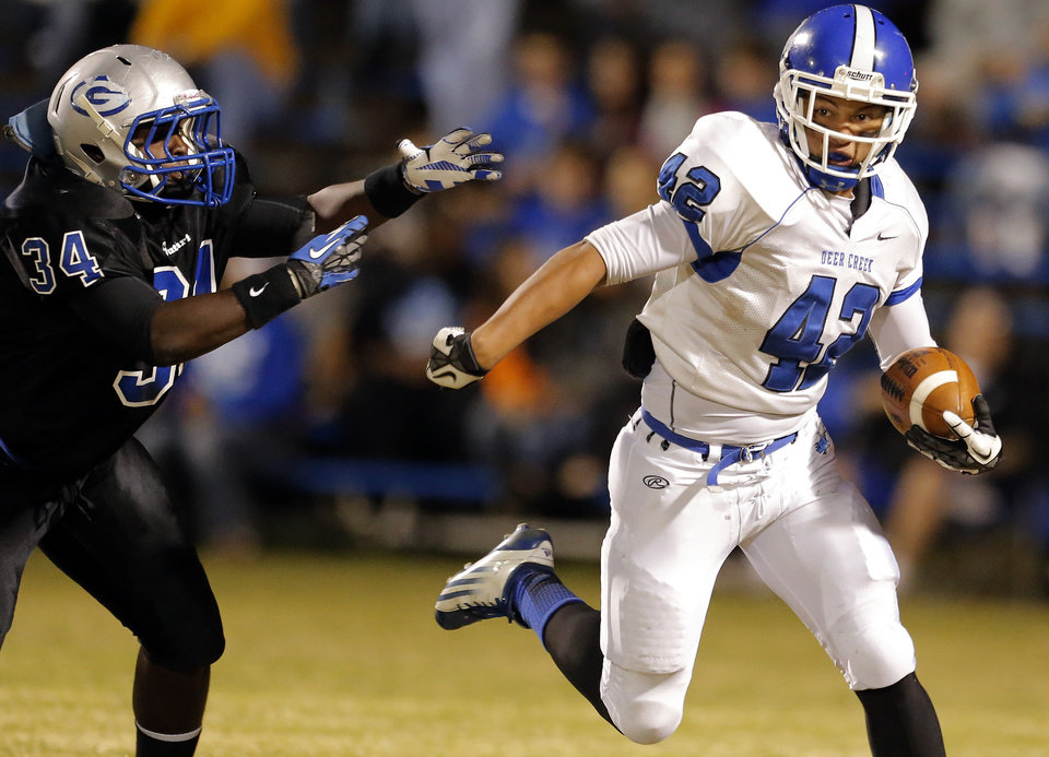 Photo - Deer Creek's Alec James gets by Guthrie Vincent Norris during the high school football game between Guthrie and Deer Creek at Guthrie, Thursday, Oct. 18, 2012. Photo by Sarah Phipps, The Oklahoman