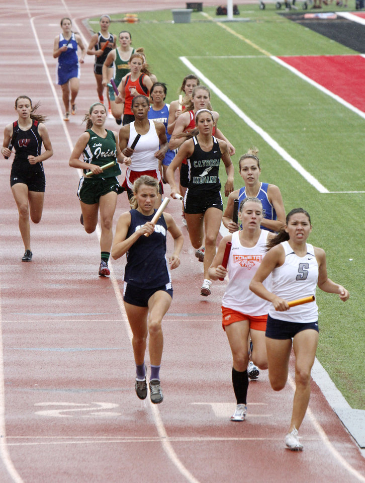 Photo - CLASS 5A / CLASS 6A / HIGH SCHOOL TRACK AND FIELD / STATE TOURNAMENT: Girls compete in the 4 x 400 relay during the 5A and 6A state finals track meet at Yukon High School in Yukon, OK, Friday, May 11, 2012,  By Paul Hellstern, The Oklahoman