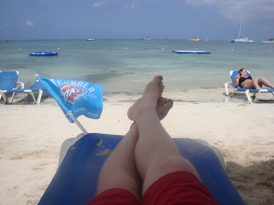 Thunder fan Clayton Kelley of Austin, Texas on the beach in Jamaica.