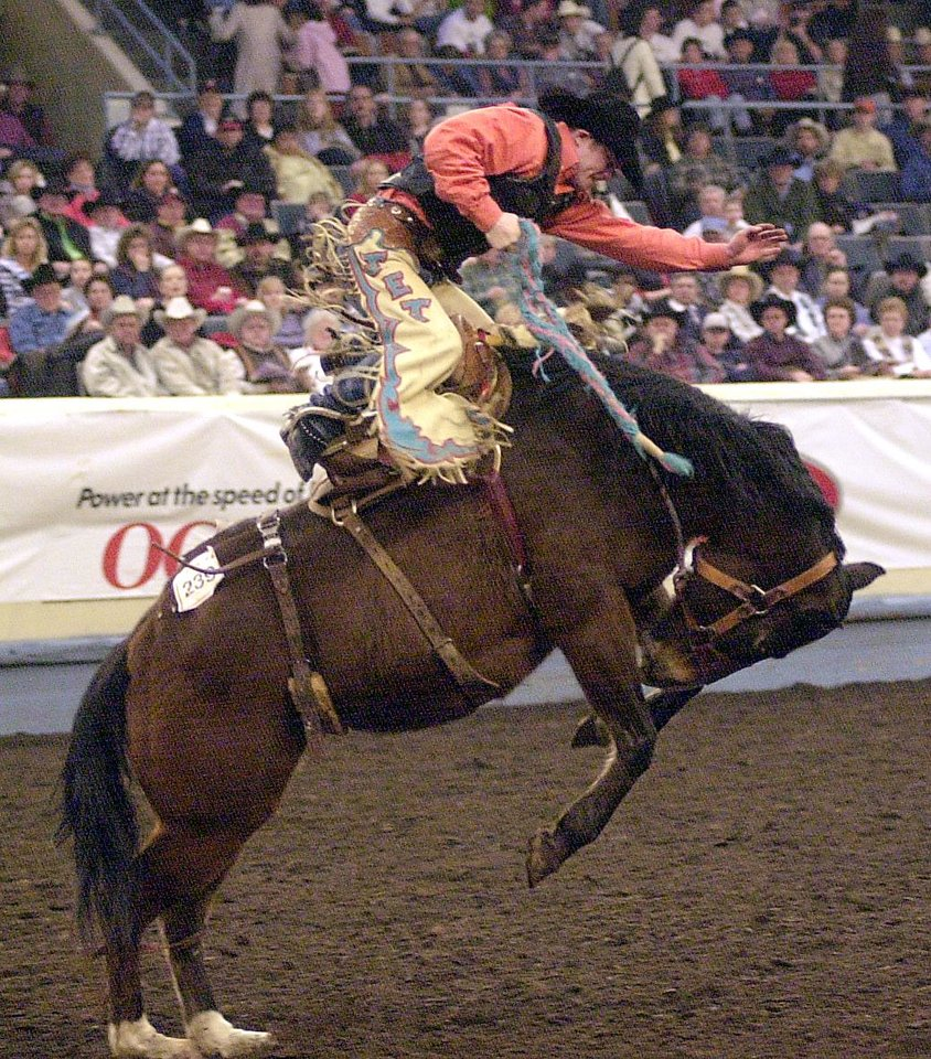 Jet McCoy of Tupelo, Okla. rides bareback during the International Finals Rodeo at the State Fair Arena Saturday afternoon.