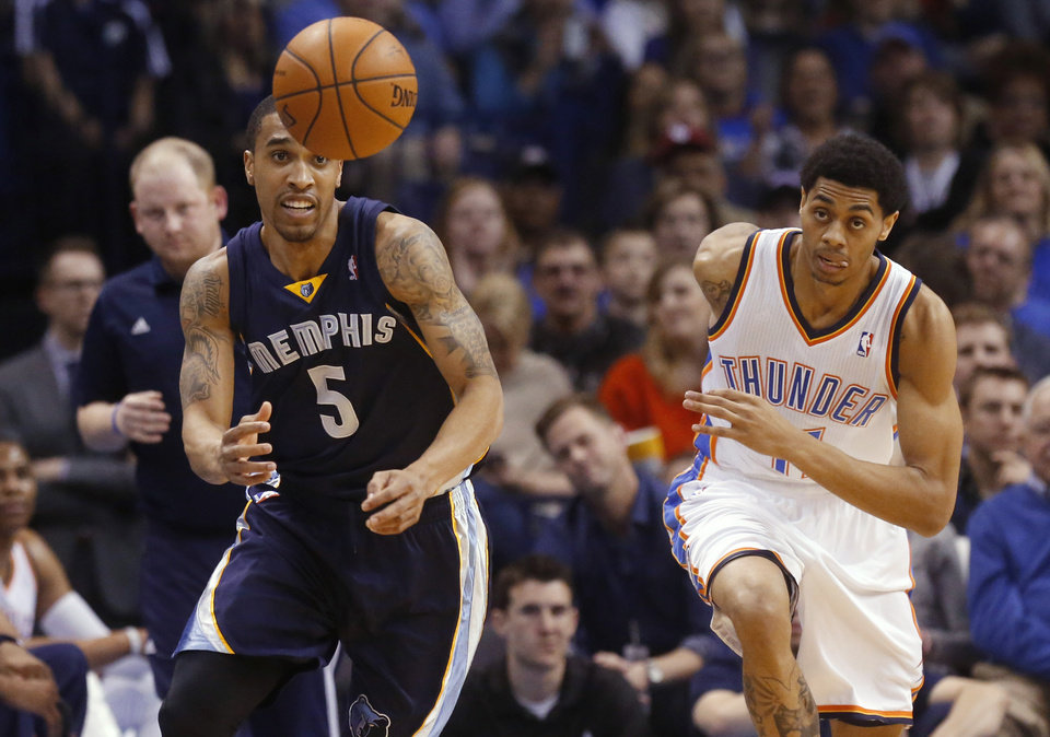 Photo - Memphis Grizzlies guard Courtney Lee (5) and Oklahoma City Thunder guard Jeremy Lamb (11) chase a loose ball during the first quarter of an NBA basketball game in Oklahoma City, Friday, Feb. 28, 2014. (AP Photo/Sue Ogrocki)