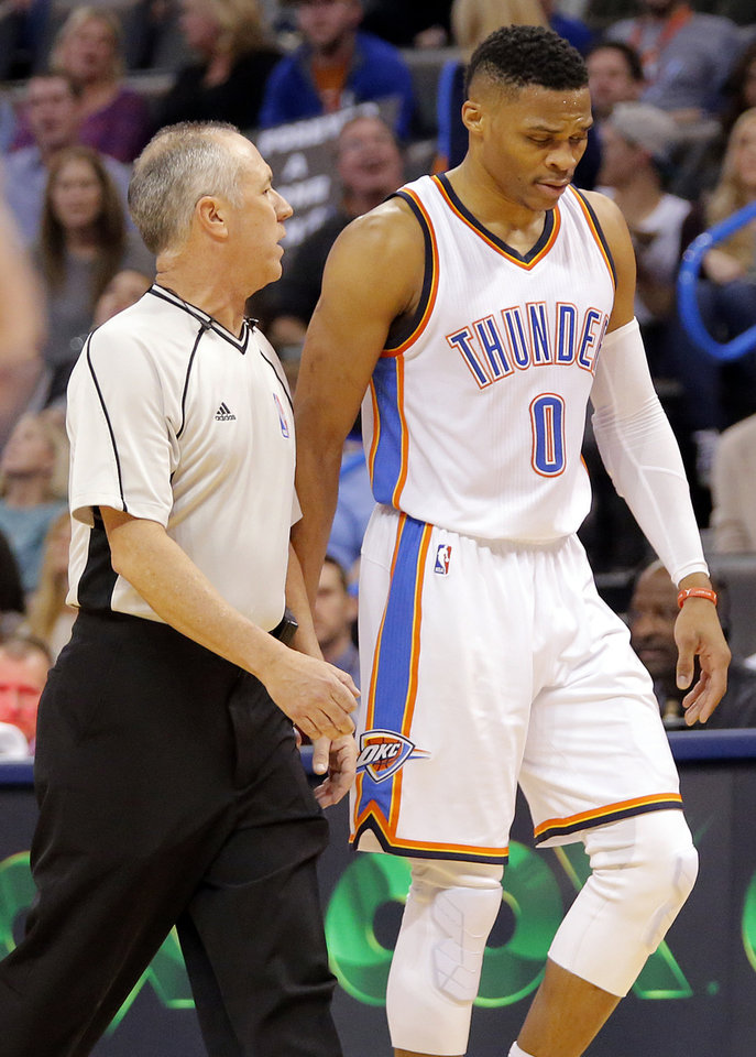 Photo - Oklahoma City's Russell Westbrook (0) is escorted off the court after being ejected on a second technical foul during the NBA basketball game between the Oklahoma City Thunder and the Dallas Mavericks at Chesapeake Energy Arena on Wednesday, Jan. 13, 2016, in Oklahoma City, Okla.  Photo by Chris Landsberger, The Oklahoman