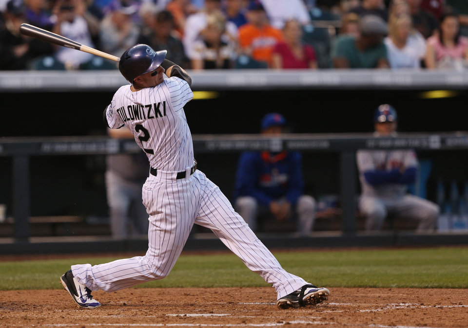 Photo - Colorado Rockies' Troy Tulowitzki singles against the New York Mets in the fourth inning of a baseball game in Denver, Saturday, May 3, 2014. (AP Photo/David Zalubowski)