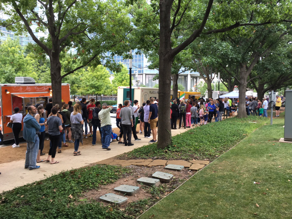 Photo -  VegFest attendees wait in long lines for the food trucks. [PHOTO BY MELISSA HOWELL, THE OKLAHOMAN]