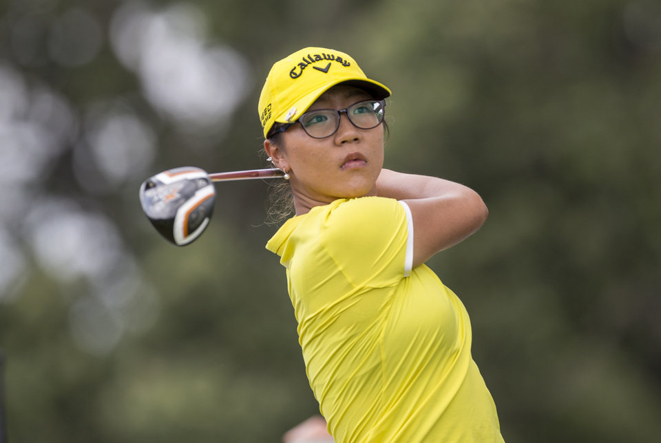 Photo - Lydia Ko, of New Zealand, hits off the 10th tee box during the final round of the NW Arkansas Championship golf tournament on Sunday, June 29, 2014, in Rogers, Ark. Ko tied for second in the tournament. (AP Photo/Beth Hall)