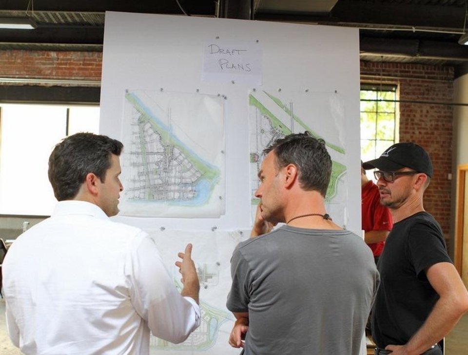 Photo -  Blair Humphreys discusses plans for Wheeler with Variety Care foundation president Andrew Rice and architect Hans Butzer. Photo by Will Hider, for The Oklahoman