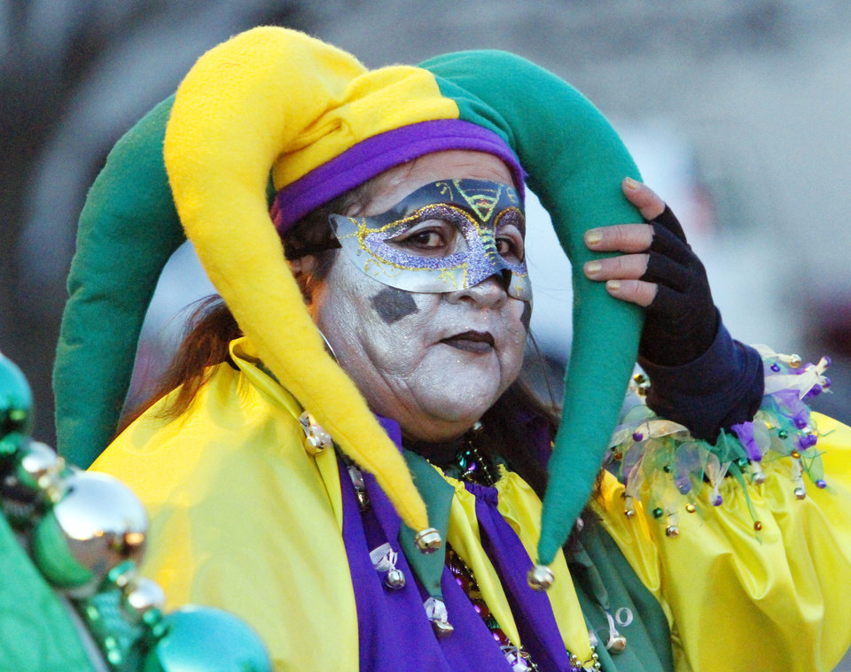 Judy Topaum, Norman, with the Sunny Day Krewe adjusts her head piece before the annual Norman Mardi Gras Parade on Saturday, March 5, 2011, in downtown Norman, Okla. Photo by Steve Sisney, The Oklahoman