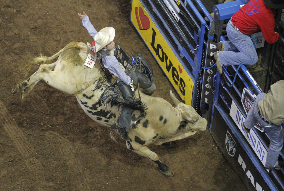 Paul Coppini, of Kuna, Idaho, competes in bull riding during the Ram National Circuit Finals Rodeo Championship in Oklahoma City, Sunday, April 1, 2012.  Photo by Garett Fisbeck, For The Oklahoman