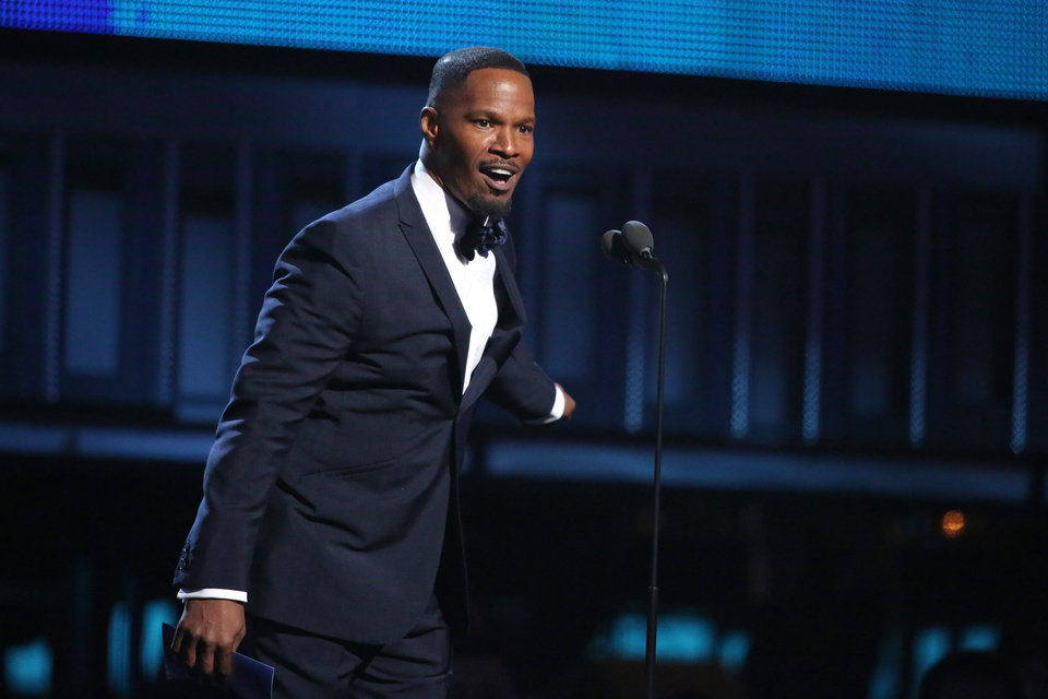 Photo - Jaime Foxx presents the award for best rap song collaboration at the 56th annual Grammy Awards at Staples Center on Sunday, Jan. 26, 2014, in Los Angeles. (Photo by Matt Sayles/Invision/AP)