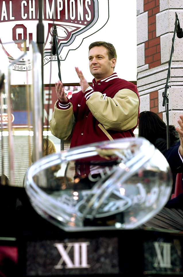 Photo - OU COLLEGE FOOTBALL NATIONAL CHAMPIONSHIP, SOONER CELEBRATION: Oklahoma Sooner head football coach Bob Stoops claps during the Sooner Championship Celebration at Memorial Stadium in Norman.